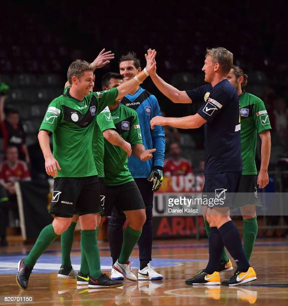 Players celebrate during the match between the Socceroos Legends and the ALeague Legends at Titanium Security Arena on July 22 2017 in Adelaide...