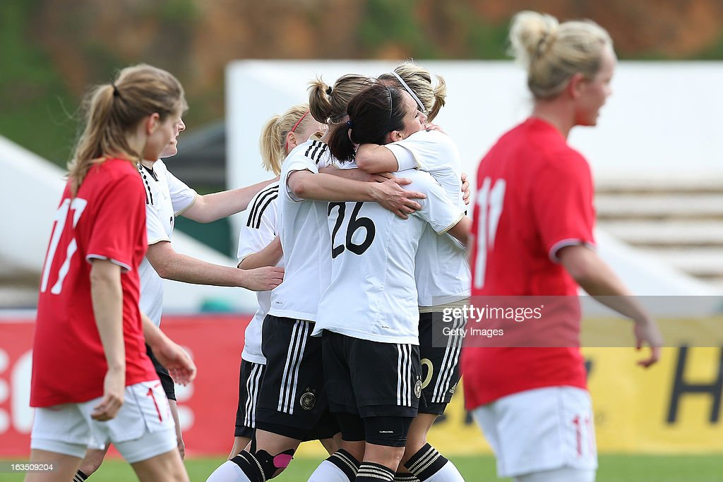 Players celebrate goal from Nadine Kebler of Germany during the Algarve Cup 2013 match between Norway and Germany at the Estadio Municipal de Lagos on March 11, 2013 in Lagos, Portugal.