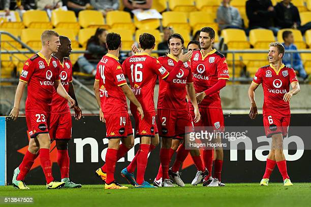 Players celebrate the goal of Bruce Djite of Adelaide United during the round 22 ALeague match between the Wellington Phoenix and Adelaide United at...
