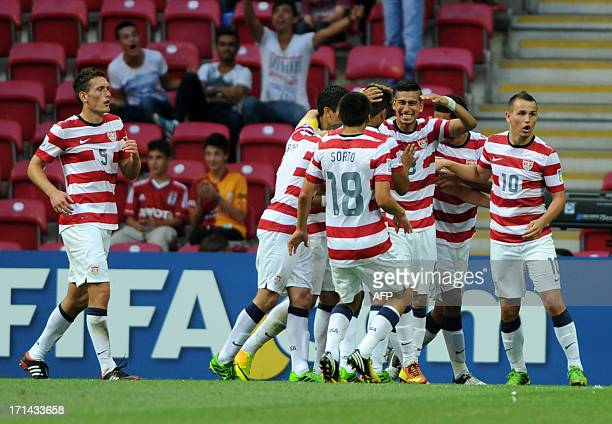 US players celebrate their goal against France during their group stage football match at the FIFA Under 20 World Cup at the Turk Telekom Arena in...