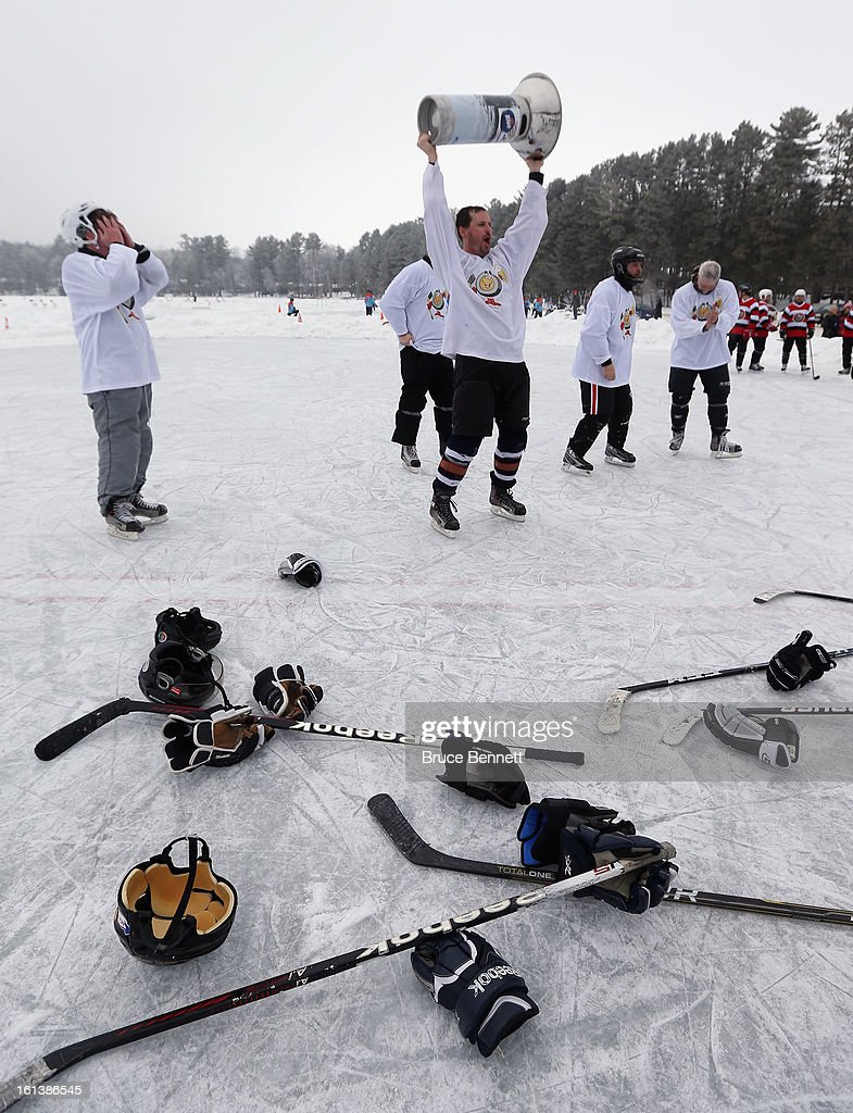 Players celebrate their victory in the 2013 USA Hockey Pond Hockey National Championships on February 10, 2013 in Eagle River, Wisconsin. The three day tournament features 2,400 participants from 30 states playing a round robin tournament on 28 rinks laid out on Dollar Lake.
