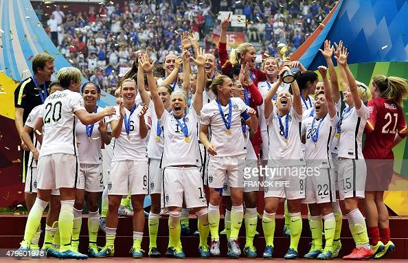 USA players celebrate with teammates after their victory in the final football match between USA and Japan during their 2015 FIFA Women's World Cup...