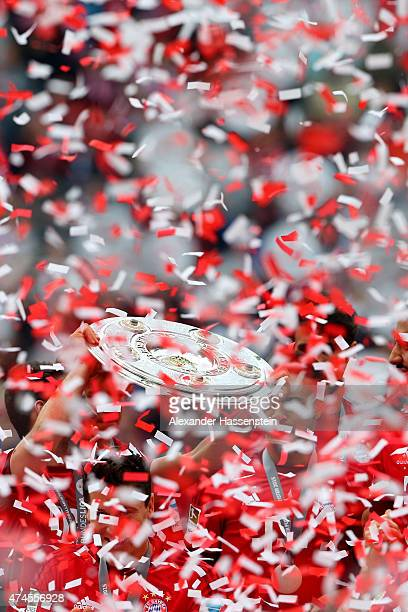 Players celebrate with the german championship trophy following the Bundesliga match between FC Bayern Muenchen and 1 FSV Mainz 05 at the Allianz...