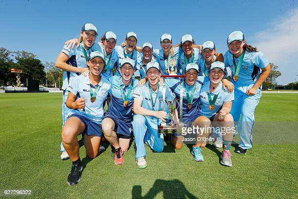 NSW players celebrate with the trophy during the WNCL Final match betwee Queensland and New South Wales at Allan Border Field on December 3 2016 in...
