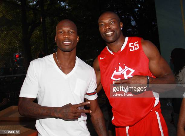 NFL players Chad Ochocinco and Terrell Owens attend the Entertainers Basketball Classic at Rucker Park on July 12 2010 in New York City