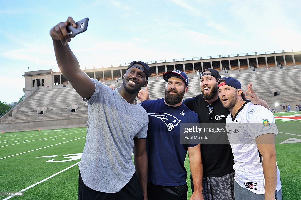 NFL players <a gi-track='captionPersonalityLinkClicked' href=/galleries/search?phrase=Chandler+Jones&family=editorial&specificpeople=7181843 ng-click='$event.stopPropagation()'>Chandler Jones</a>, <a gi-track='captionPersonalityLinkClicked' href=/galleries/search?phrase=Rob+Ninkovich&family=editorial&specificpeople=741417 ng-click='$event.stopPropagation()'>Rob Ninkovich</a>, <a gi-track='captionPersonalityLinkClicked' href=/galleries/search?phrase=Dane+Fletcher&family=editorial&specificpeople=5517050 ng-click='$event.stopPropagation()'>Dane Fletcher</a> and <a gi-track='captionPersonalityLinkClicked' href=/galleries/search?phrase=Julian+Edelman&family=editorial&specificpeople=4489543 ng-click='$event.stopPropagation()'>Julian Edelman</a> attend the Tom Brady Football Challenge for The Best Buddies Challenge: Hyannis Port 2015 at Harvard Field on May 29, 2015 in Allston, Massachusetts.