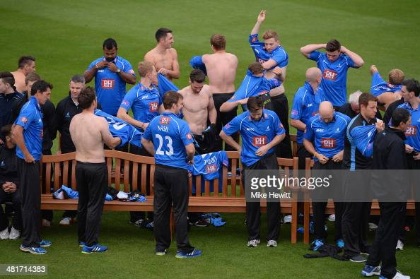 Players change shirts during a Sussex CCC photocall at the County Ground on March 31 2014 in Hove England