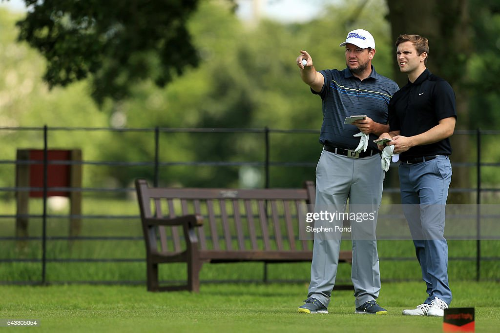 Players check yardage during the PGA Fourball Qualifier at Ashridge Golf Club on June 27, 2016 in Ashridge, England.