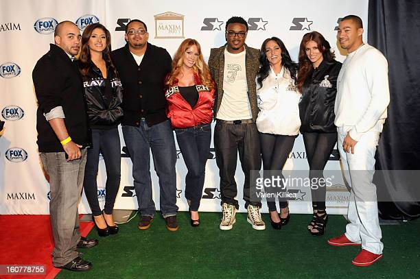 NFL players Chuck Wells Antonio Young Brandon Carr and Champ Bailey pose on the Starter Red Carpet at the Maxim Party during Super Bowl XLVII at...