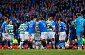 Players clash after Scott Brown of Celtic received a yellow card during the Scottish League Cup SemiFinal between Celtic and Rangers at Hampden Park...