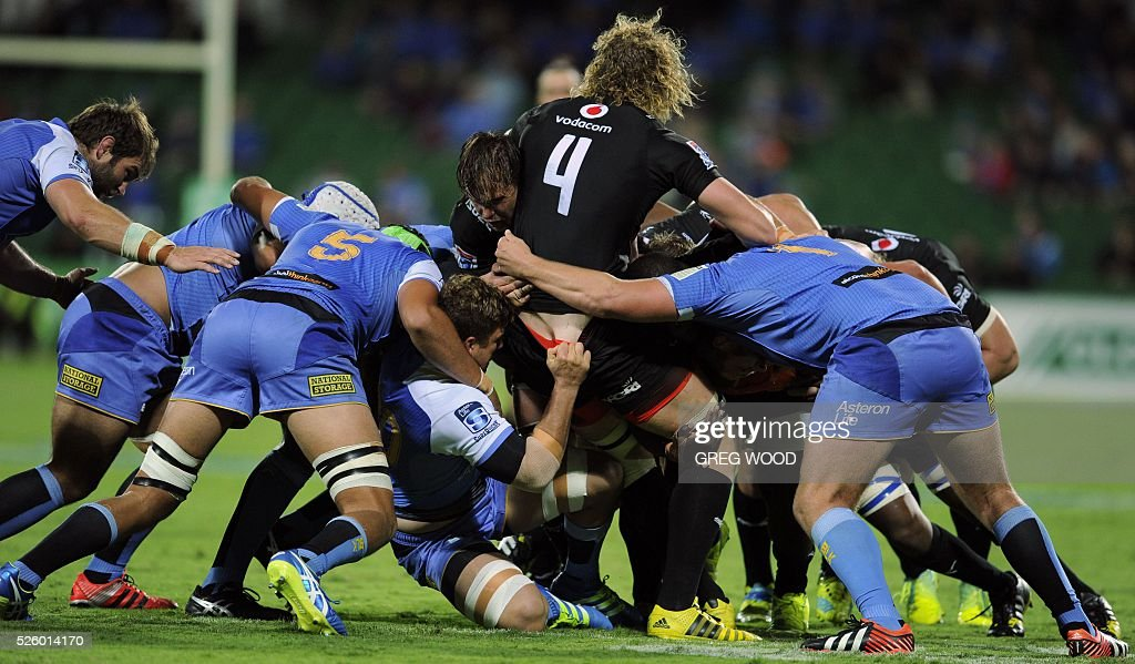 Players clash during the Super Rugby match between Australias Western Force and South Africas Bulls in Perth on April 29, 2016. AFP PHOTO / GREG WOOD--IMAGE RESTRICTED TO EDITORIAL USE NO COMMERCIAL USE-- / AFP / Greg Wood