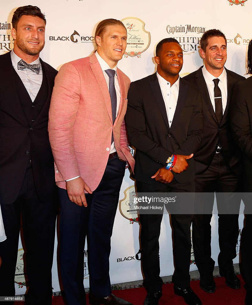 NFL players <a gi-track='captionPersonalityLinkClicked' href=/galleries/search?phrase=Clay+Matthews+III&family=editorial&specificpeople=7446605 ng-click='$event.stopPropagation()'>Clay Matthews III</a> (2nd L) and <a gi-track='captionPersonalityLinkClicked' href=/galleries/search?phrase=Aaron+Rodgers+-+American+Football+Quarterback&family=editorial&specificpeople=215257 ng-click='$event.stopPropagation()'>Aaron Rodgers</a> (R) attend the Fourth Annual Fillies & Stallions party sponsored by Captain Morgan White Rum at Mellwood Arts Center on May 2, 2014 in Louisville, Kentucky.