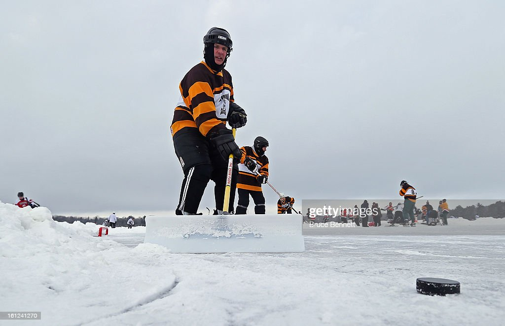 Players clean off the ice surface prior to their game in the 2013 USA Hockey Pond Hockey National Championships on February 9, 2013 in Eagle River, Wisconsin. The three-day tournament features 2,400 participants from 30 states playing a round robin tournament on 28 rinks laid out on Dollar Lake.