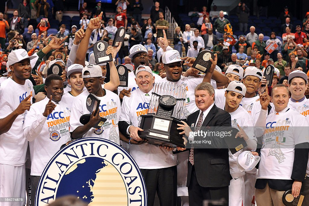 Players, coaches and staff of the Miami Hurricanes pose for photos following their 88-77 victory against the North Carolina Tar Heels during the finals of the 2013 Men's ACC Tournament at the Greensboro Coliseum on March 17, 2013 in Greensboro, North Carolina.