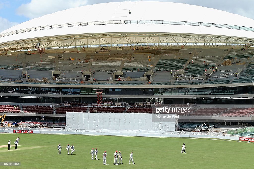 Players come from the field at lunch during day one of the Sheffield Shield match between the Redbacks and the Warriors at Adelaide Oval on November 13, 2013 in Adelaide, Australia.