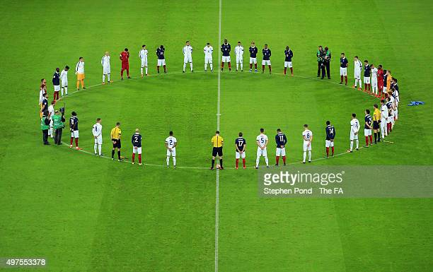 Players come together for the minutes silence remember those who lost their lives in the recent Paris attack prior to the International Friendly...