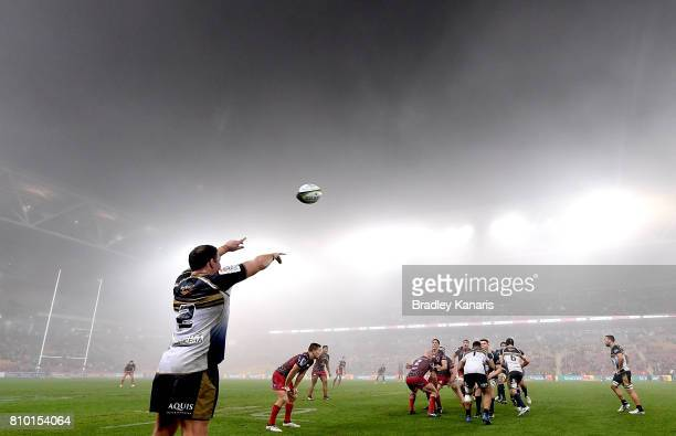 Players compete at the lineout as fog can be seen blanketing the ground during the round 16 Super Rugby match between the Reds and the Brumbies at...
