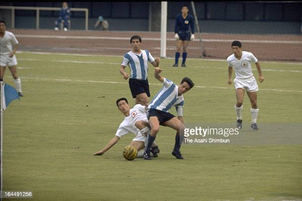 Players compete during the Men's Football Group D match between Japan and Argentina during Tokyo Olympic at Komazawa Stadium on October 14 1964 in...