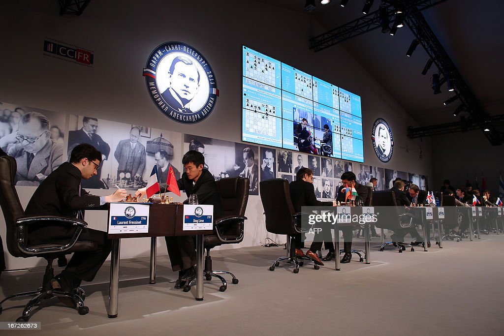 Players compete during their round 3 game of the Alekhine Memorial chess tournament on April 23, 2013 in Paris. The tournament is a 10-player single round competition, with the first half held in Paris from April 20 to 25, and the second half in the Russian State Museum in St. Petersburg from April 26 to May 1st.
