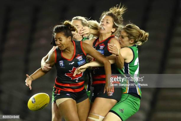 Players compete for the ball during the 2017 International Cup Women's Grand Final match between Canada and Ireland at Etihad Stadium on August 19...