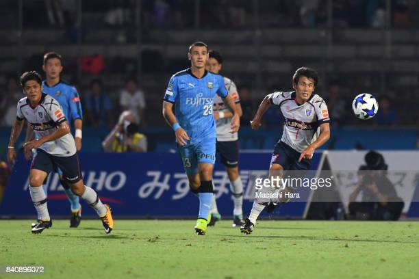 Players compete for the ball during the JLeague Levain Cup quarter final first leg match between Kawasaki Frontale and FC Tokyo at Todoroki Stadium...