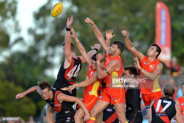 Players compete for the ball during the JLT Community Series AFL match between the Gold Coast Suns and the Essendon Bombers at Harrup Park Country...