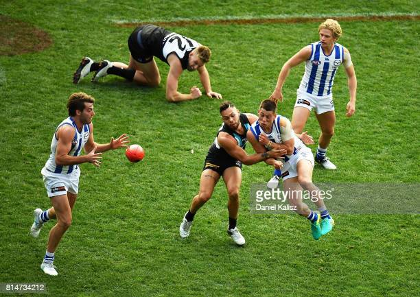 Players compete for the ball during the round 17 AFL match between the Port Adelaide Power and the North Melbourne Kangaroos at Adelaide Oval on July...