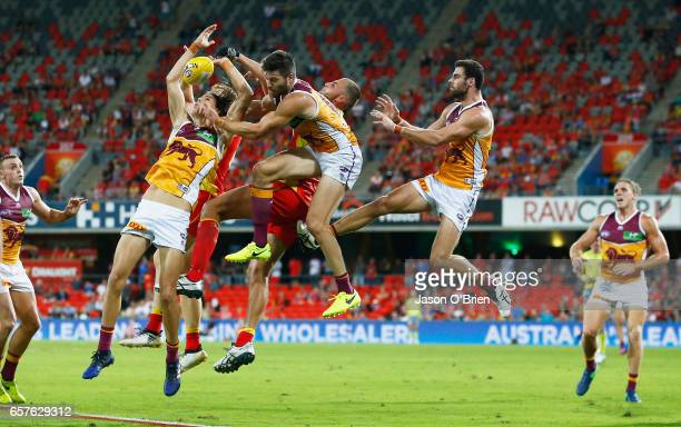 Players compete for the ball during the round one AFL match between the Gold Coast Suns and the Brisbane Lions at Metricon Stadium on March 25 2017...