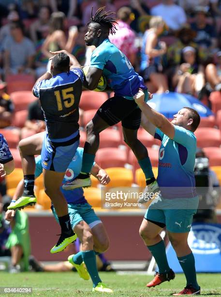 Players compete for the ball during the Rugby Global Tens match between the Bulls and Western Force at Suncorp Stadium on February 11 2017 in...