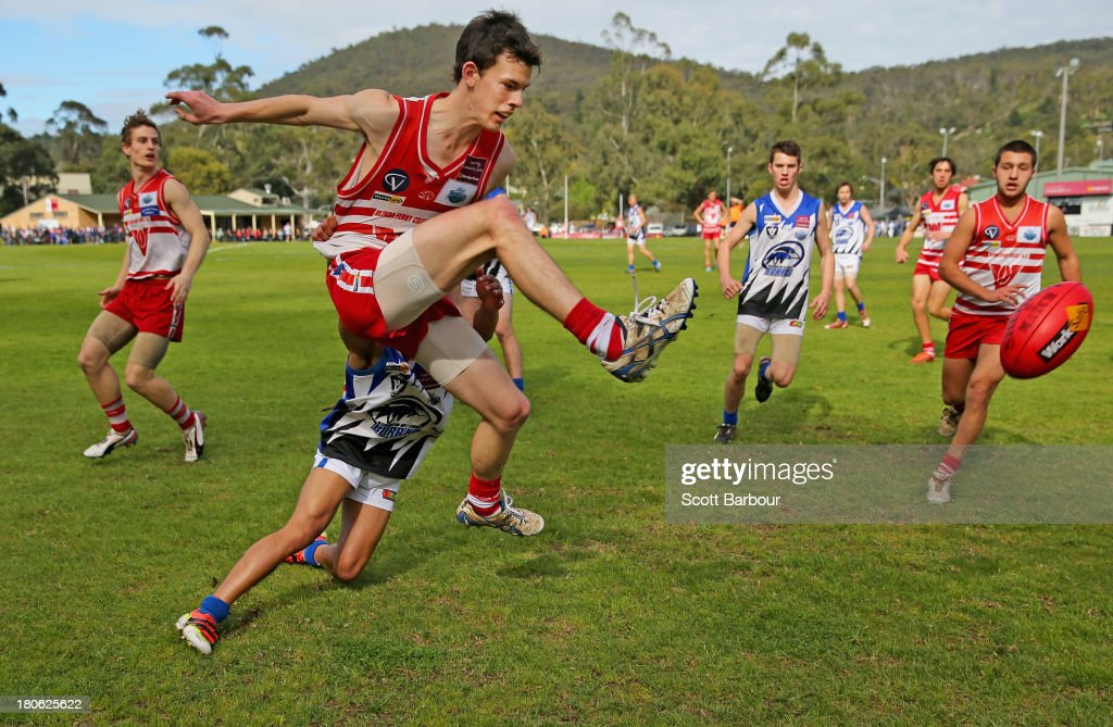 Players compete for the ball during the Yarra Valley Mountain District Football League Under 18 Grand Final between Olinda Ferny Creek and Warburton Millgrove at Yarra Junction Football Ground on September 14, 2013 in Melbourne, Australia.