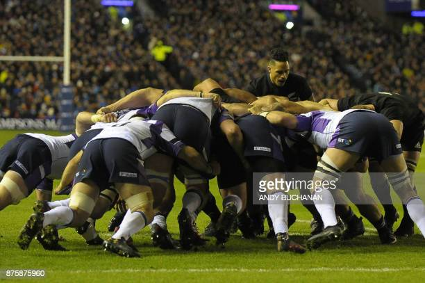 Players compete for the ball in a scrum during the international rugby union test match between Scotland and New Zealand at Murrayfield stadium in...