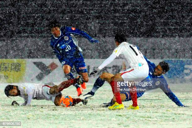 Players compete in the snow during the JLeague J2 match between Montedio Yamagata and FC Gifu at ND Soft Stadium Yamagata on November 19 2017 in...