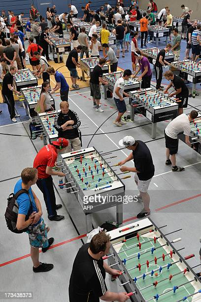 Players compete in the table football Garlando World Championship Series on July 14 2013 in Salzburg Austria AFP PHOTO / WILDBILD
