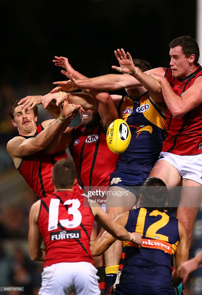 Players contest a mark during the round 15 AFL match between the West Coast Eagles and the Essendon Bombers at Domain Stadium on June 30, 2016 in Perth, Australia.