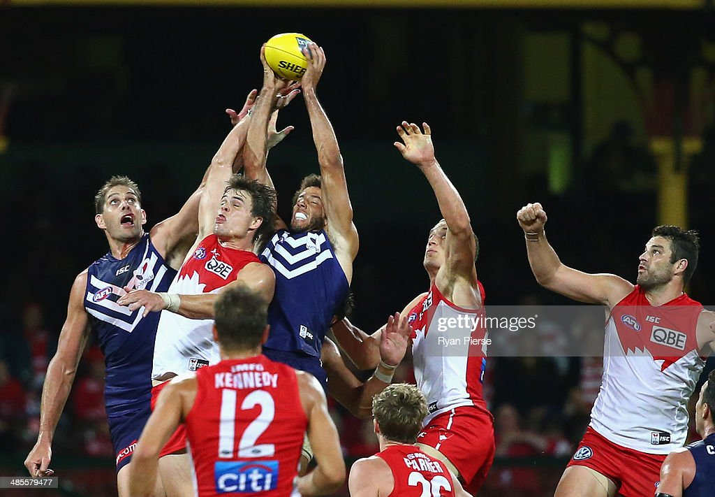Players contest the ball during the round five AFL match between the Sydney Swans and the Fremantle Dockers at Sydney Cricket Ground on April 19, 2014 in Sydney, Australia.