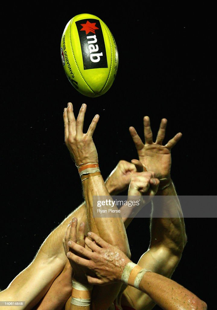 Players contest the ball during the round two NAB Cup AFL match between the Sydney Swans and the North Melbourne Kangaroos at Bruce Purser Oval on March 3, 2012 in Sydney, Australia.