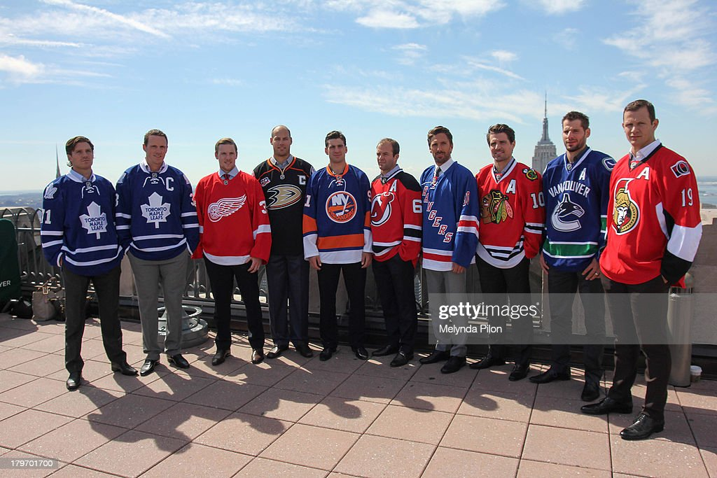 NHL players (L to R) David Clarkson and Dion Phaneuf of the Toronto Maple Leafs, Jimmy Howard of the Detroit Red Wings, Ryan Getzlaf of the Anaheim Ducks, John Tavares of the New York Islanders, Andy Greene of the New Jersey Devils, Henrik Lundqvist of the New York Rangers, Patrick Sharp of the Chicago Blackhawks, Ryan Kesler of the Vancouver Canucks and Jason Spezza of the Ottawa Senators visit the Top of the Rock to celebrate the start of the 2013-14 NHL season, including the six regular-season games set to be played in outdoor locations, at the Top of the Rock Observation Deck at Rockefeller Center on September 6, 2013 in New York City.