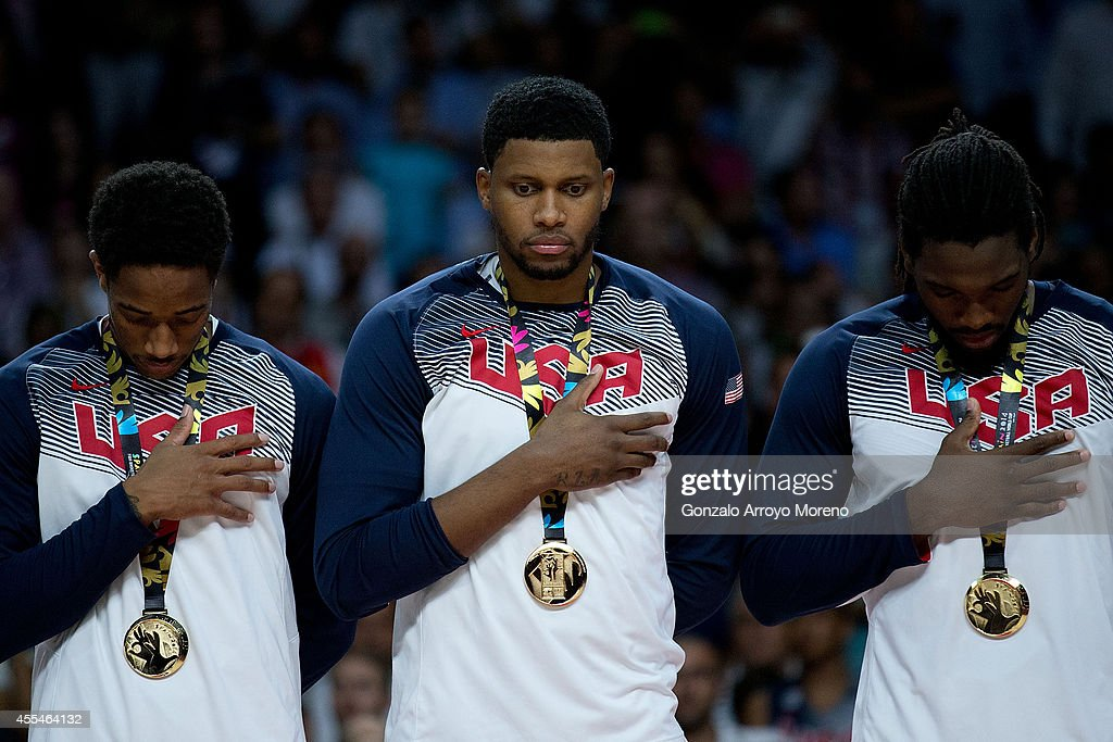 USA players Demar Derozan Rudy Gay and Kenneth Faried listen their national anthem during the award ceremony after the 2014 FIBA World Basketball...