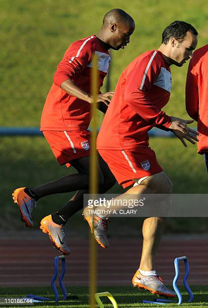 US players DeMarcus Beasley and Landon Donovan take part in drills during a training session at Pilditch Stadium on June 9 2010 in preparation for...