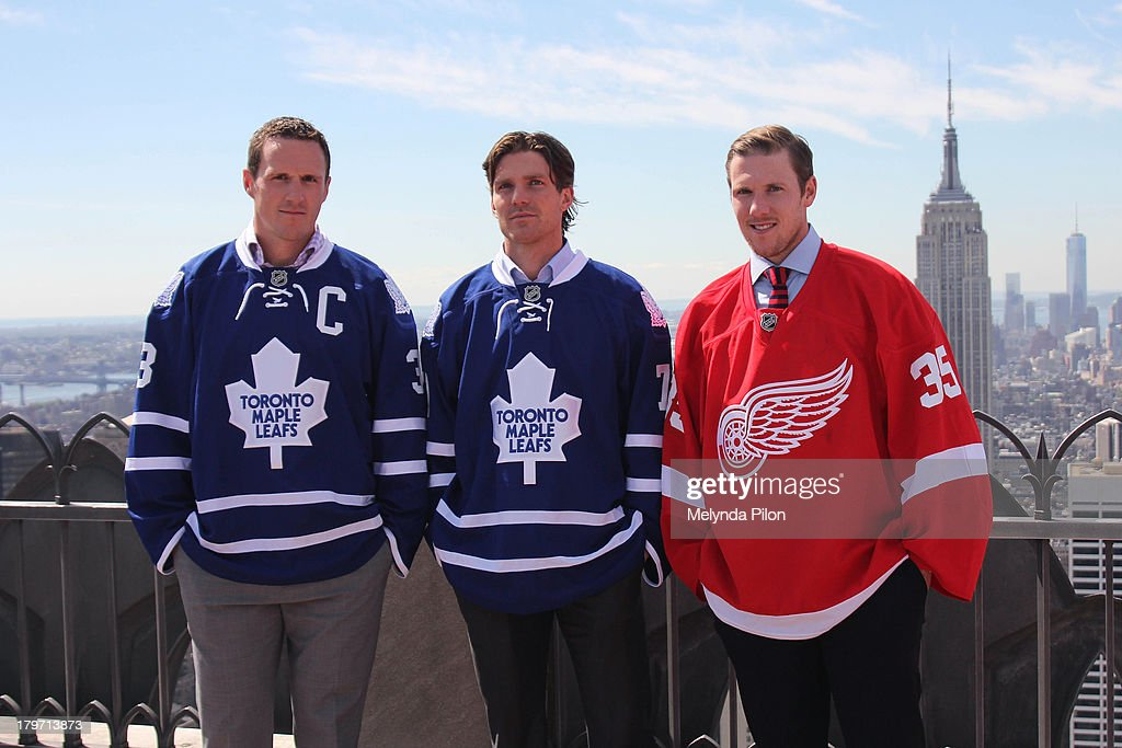 NHL players (L to R) <a gi-track='captionPersonalityLinkClicked' href=/galleries/search?phrase=Dion+Phaneuf&family=editorial&specificpeople=545455 ng-click='$event.stopPropagation()'>Dion Phaneuf</a> and David Clarkson of the Toronto Maple Leafs and <a gi-track='captionPersonalityLinkClicked' href=/galleries/search?phrase=Jimmy+Howard&family=editorial&specificpeople=2118637 ng-click='$event.stopPropagation()'>Jimmy Howard</a> of the Detroit Red Wings visit the Top of the Rock to celebrate the start of the 2013-14 NHL season, including the six regular-season games set to be played in outdoor locations, at the Top of the Rock Observation Deck at Rockefeller Center on September 6, 2013 in New York City.
