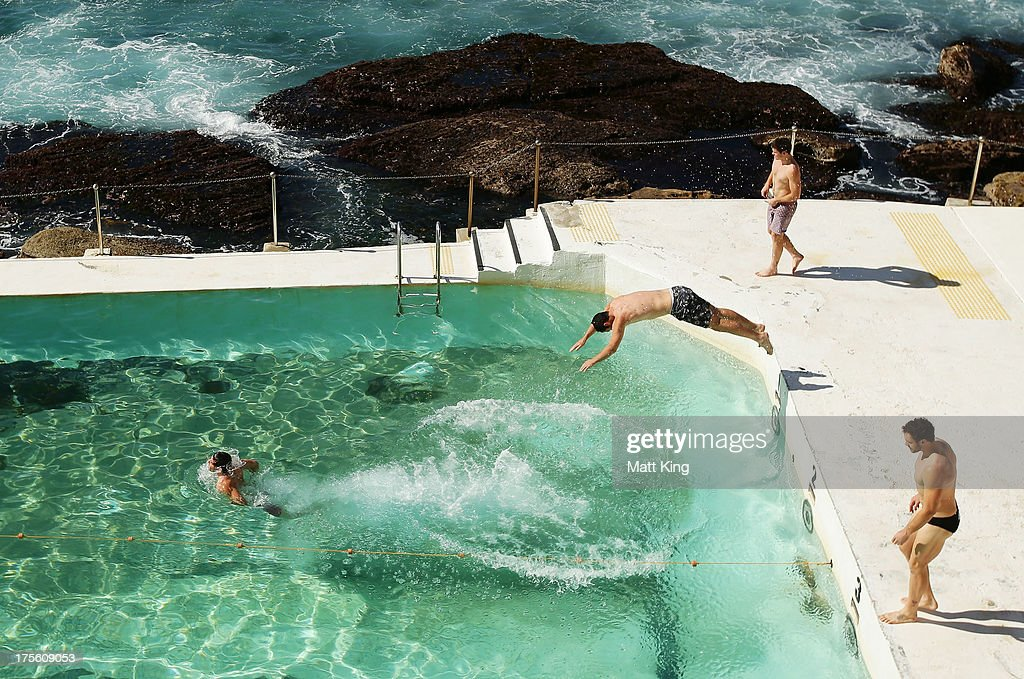 Players dive into the pool during a Sydney Swans AFL recovery session at Bondi Icebergs Pool on August 5, 2013 in Sydney, Australia.