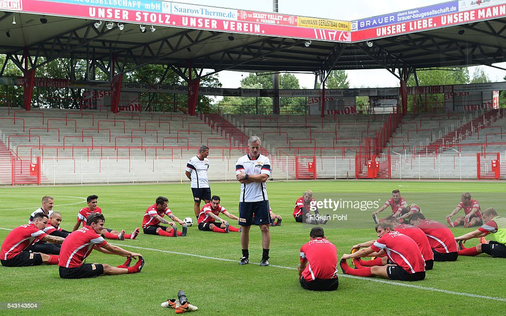 Players do some stretching exercises during training on June 26, 2016 in Berlin, Germany.