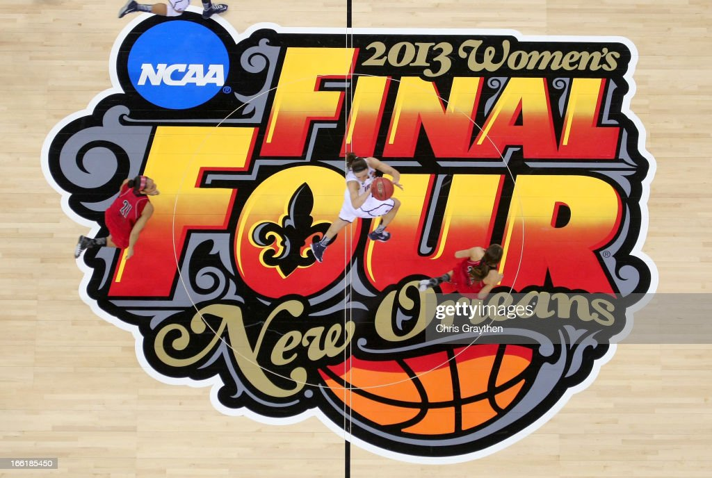 Players dribble across the center court logo during the 2013 NCAA Women's Final Four Championship between the Connecticut Huskies and the Louisville Cardinals at New Orleans Arena on April 9, 2013 in New Orleans, Louisiana.