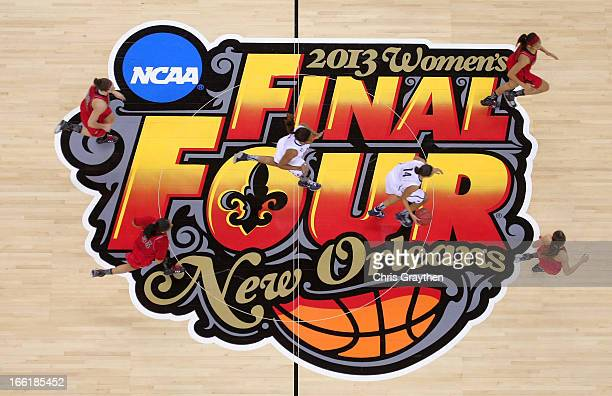 Players dribble across the center court logo during the 2013 NCAA Women's Final Four Championship between the Connecticut Huskies and the Louisville...