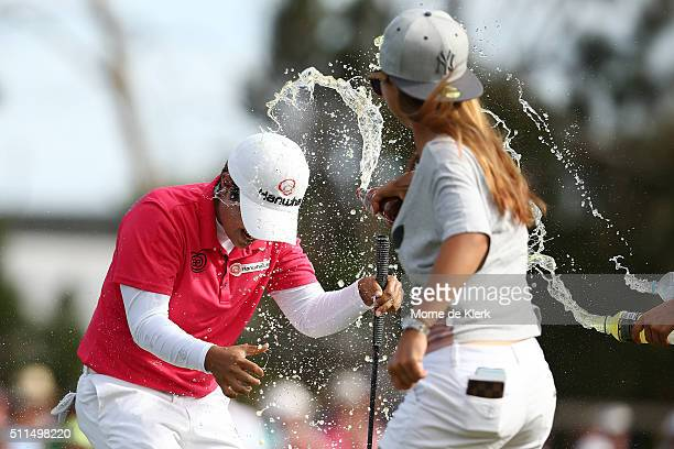 Players dump drinks on the head of Haru Nomura of Japan in celebration after Nomura won the Women's Australian Open during day four of the ISPS Handa...