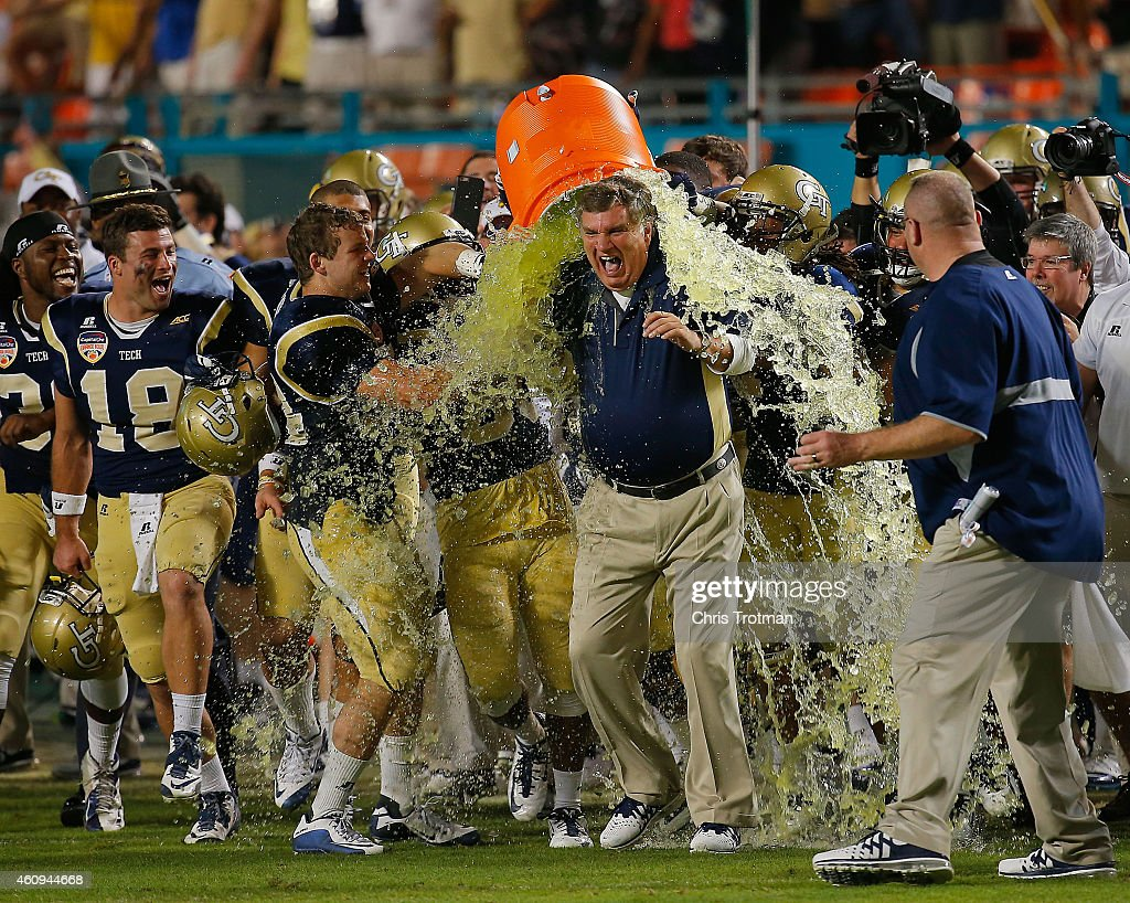 Players dump Gatorade on head coach Paul Johnson of the Georgia Tech Yellow Jackets at the end of the Capital One Orange Bowl game against the...