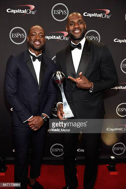 NBA players Dwyane Wade and LeBron James pose with the Best Male Athlete award backstage during the 2016 ESPYS at Microsoft Theater on July 13 2016...