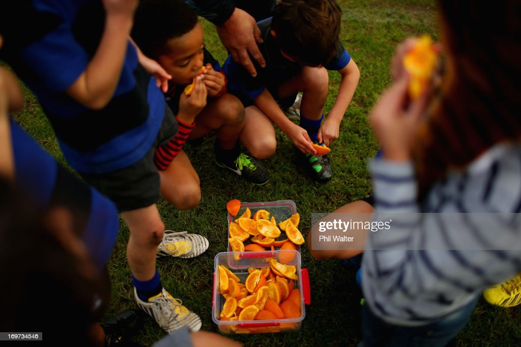 Players eat oranges at halftime during the Ponsonby vs Eden under 6 childrens rugby match at Cox's Bay Reserve on June 1, 2013 in Auckland, New Zealand. Rugby Union is the unofficial national sport of New Zealand and is often referred to by New Zealanders, as an integral part of their culture.