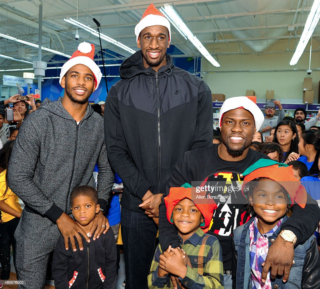 NBA players Ekpe Udoh, Chris Paul, actor Kevin Hart, Chris's son Christopher Emmanuel Paul II and Kevin's children Heaven Hart and Hendrix Hart attend the CP3 Foundation's 100 Children for Holiday Shopping Spree hosted by Chris Paul and Kevin Hart at Toys R' Us on December 16, 2014 in Torrance, California.