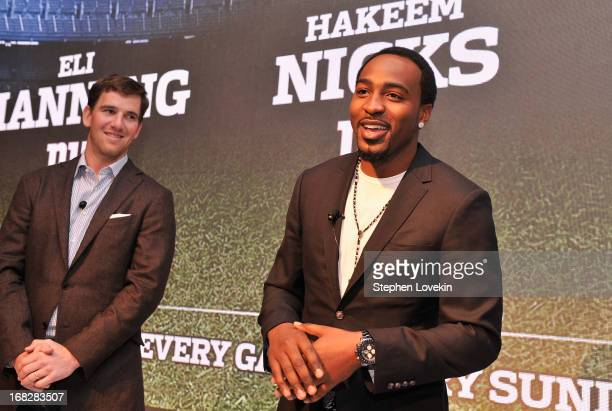 Players Eli Manning and Hakeem Nicks speak on stage at DIRECTV's 2013 National Ad Sales Upfront on May 7 2013 in New York City